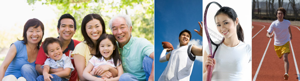 Image displays a smiling asian family - two children, 4 adults, a young male throwing a football, a young asian woman smiling while holding a tennis racket, a young man running on a track